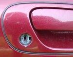 016 EXTERIOR - front passenger door lock trim damage.jpg